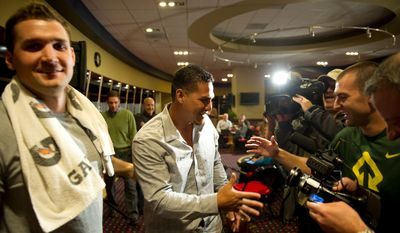 Wilson Ramos greets teammates Ryan Zimmerman, left, and Steve Lombardozzi in the Nationals clubhouse after a brief press conference. It was the first time he'd seen either since he was kidnapped in Venezuela last week.