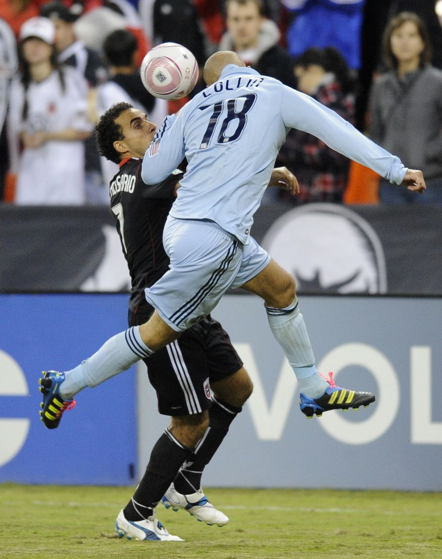 D.C. United's Dwayne De Rosario, left, battles for the ball against Sporting Kansas City defender Aurelien Collin, right, during the second half of an MLS soccer game, Saturday, Oct. 22, in Washington. Kansas City won 1-0. (AP Photo/Nick Wass)