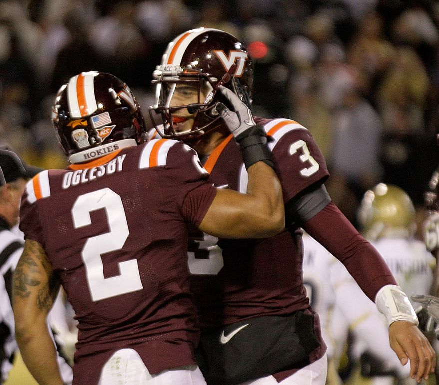 Virginia Tech quarterback Logan Thomas threw for two touchdowns on 195 yards and ran for another as Tech slipped past North Carolina on Thursday night, 24-21. (AP Photo/Steve Helber)