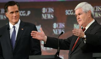 **FILE** Republican presidential candidate Newt Gingrich (left) speaks Nov. 12, 2011, during the CBS News/National Journal foreign policy debate at the Benjamin Johnson Arena in Spartanburg, S.C., as fellow candidate and former Mass. Gov. Mitt Romney listens. (Associated Press)