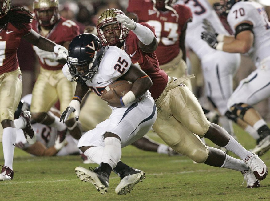 Florida State's Vince Williams tackles Virginia's Kevin Parks (25)in the first quarter of an NCAA college football game on Saturday, Nov. 19, 2011, in Tallahassee, Fla.(AP Photo/Steve Cannon)
