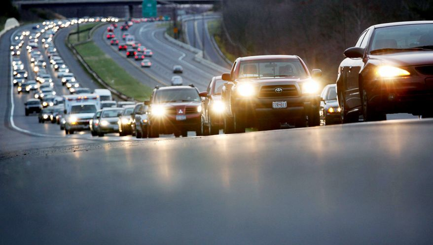 """Auto traffic for this Thanksgiving holiday is expected to rise, according to AAA. """"The increase in holiday travelers can be attributed to a ... strengthening economy,"""" the AAA says, but the increase will only be """"slight."""" (Associated Press)"""