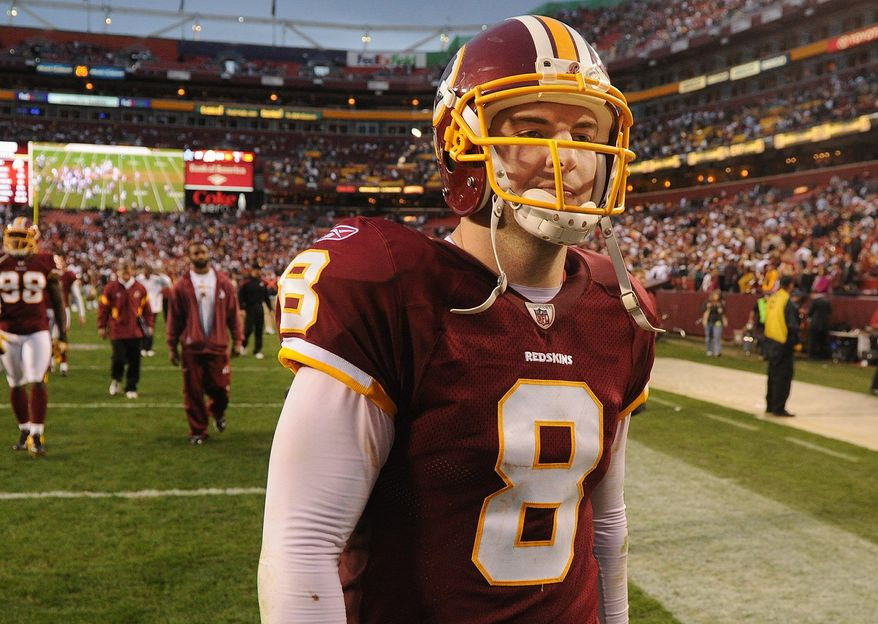 Redskins quarterback Rex Grossman passed for 289 yards and two touchdowns against Dallas. He was intercepted once. (Andrew Harnik/The Washington Times)