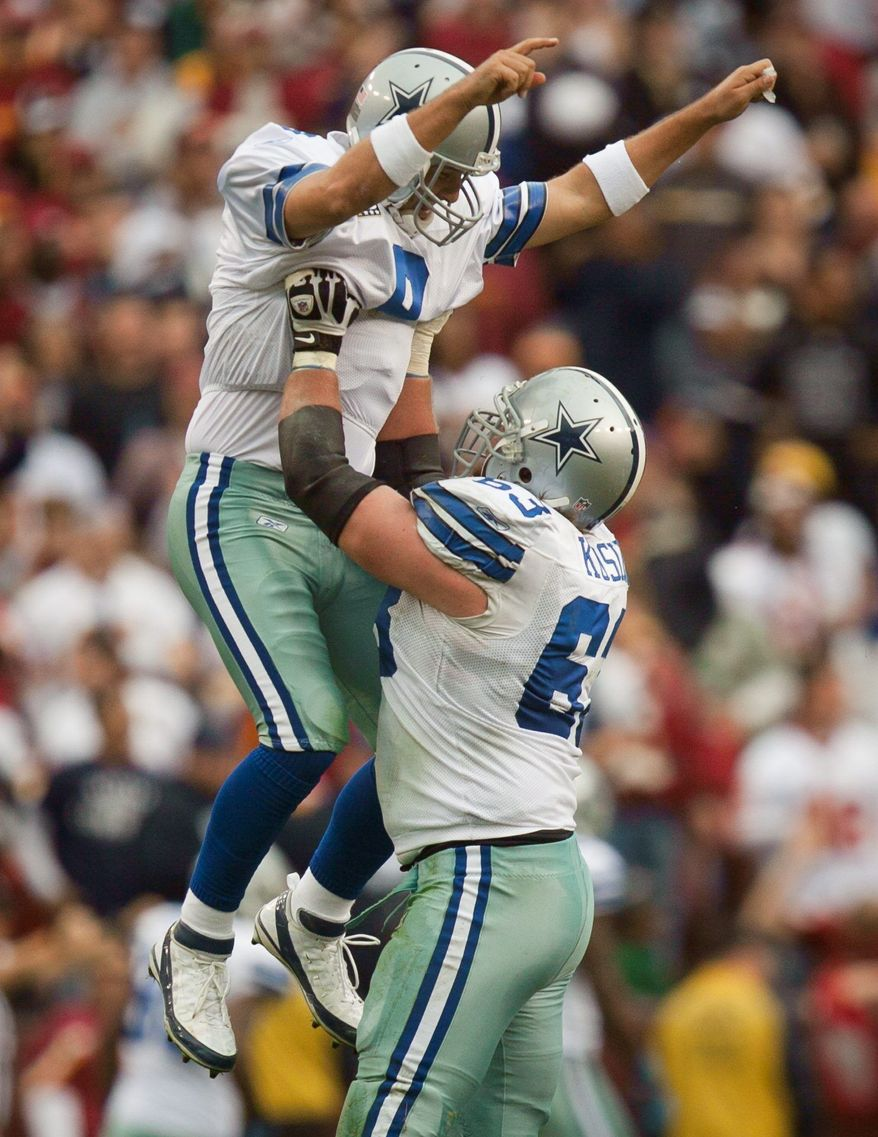 Quarterback Tony Romo (9) of the Dallas Cowboys celebrates with guard Kyle Kosier (63) after throwing a 59-yard touchdown pass to tight end Jason Witten during the fourth quarter of the game against the Washington Redskins at FedEx Field in Landover, Md. on Sunday, November 20, 2011. (Pratik Shah/The Washington Times)