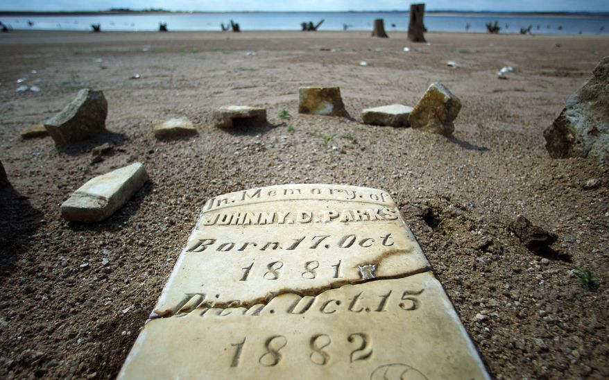 "A 19th-Century child's watery gravesite is visible in Bluffton, Texas, because the water level of Lake Buchanan has been receding as drought shrinks the state's largest inland lake. ""Most people in Texas probably didn't realize what was under these lakes,"" says a Texas historical commission official."