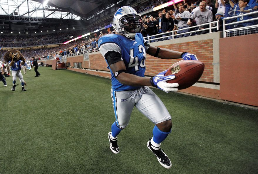 Detroit strong safety Chris Harris celebrates his interception of a pass by Carolina quarterback Cam Newton during the fourth quarter. The Lions trailed the Panthers 24-7 before rallying to win 49-35. (Associated Press)