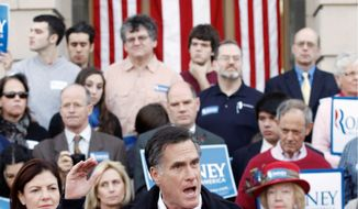 Former Massachusetts Gov. Mitt Romney, a Republican presidential candidate, speaks to supporters outside City Hall in Nashua, N.H., on Sunday. Sen. Kelly Ayotte (left) of New Hampshire listens. Mrs. Ayotte endorsed Mr. Romney.  (Associated Press)