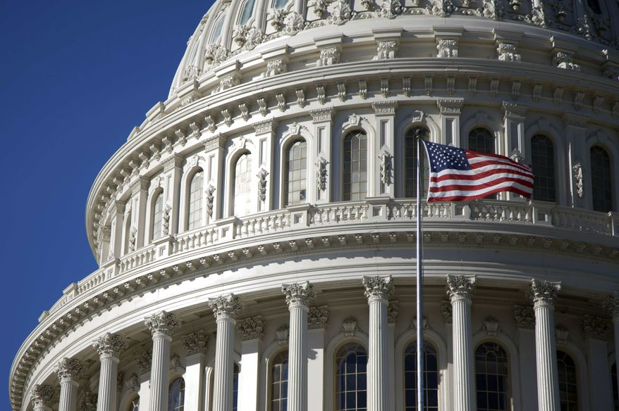 The U.S. Capitol building is seen Saturday, Nov. 19, 2011, in Washington. The six Democrats and six Republicans on the supercommittee, as it's familiarly called, have until next Wednesday, Nov. 23, to come together on a deficit reduction plan. (AP Photo/Carolyn Kaster)
