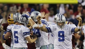Dallas Cowboys quarterback Tony Romo reacts after Dan Bailey kicks the game-winning field goal during overtime against the Washington Redskins in Landover, Md., on Sunday, Nov. 20, 2011. The Cowboys won 27-24. (AP Photo/Pablo Martinez Monsivais)