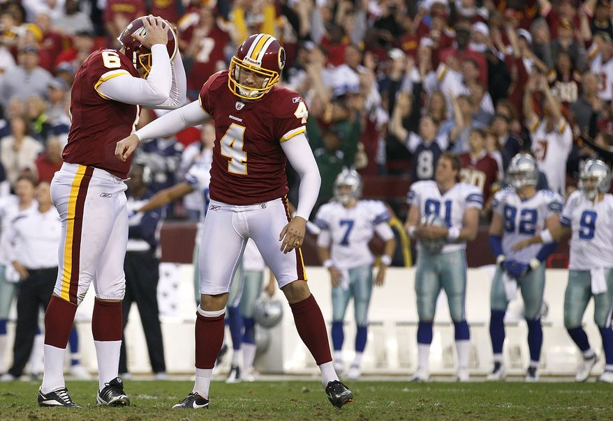 Washington Redskins holder Sav Rocca and kicker Graham Gano react after missing a field goal during overtime against the Dallas Cowboys in Landover, Md., on Sunday, Nov. 20, 2011. The Cowboys won 27-24. (AP Photo/Evan Vucci)