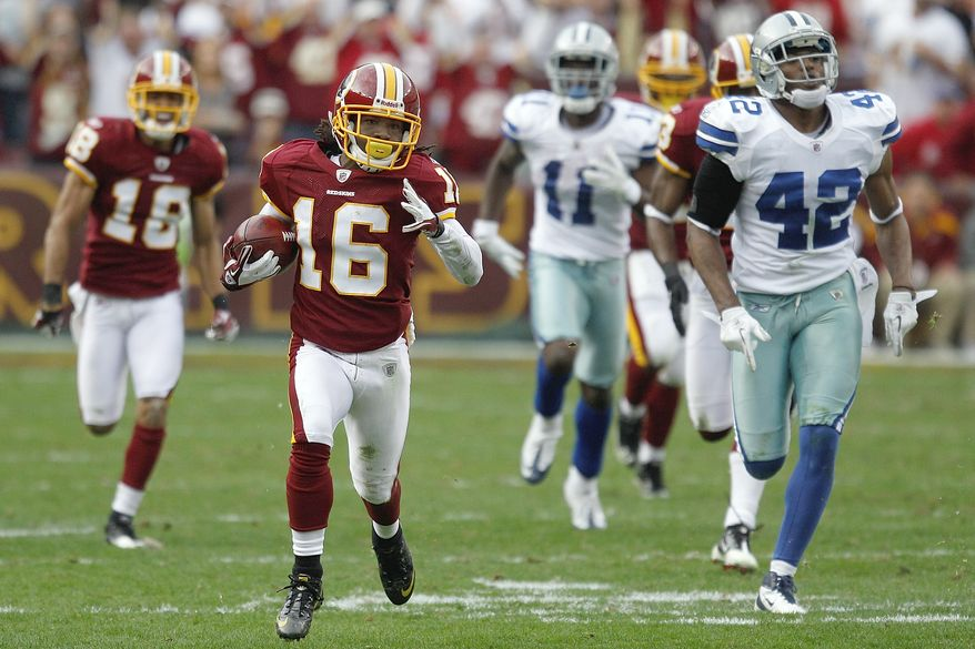 Washington Redskins wide receiver Brandon Banks returns a kickoff during the second half against the Dallas Cowboys in Landover, Md., on Sunday, Nov. 20, 2011. (AP Photo/Evan Vucci)