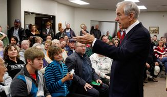 Republican Presidential hopeful Texas Rep. Ron Paul answers a question during a campaign event Friday, Nov. 18, 2011, at the Lawrence Community Center in Anamosa, Iowa. (AP Photo/The Gazette, Brian Ray)