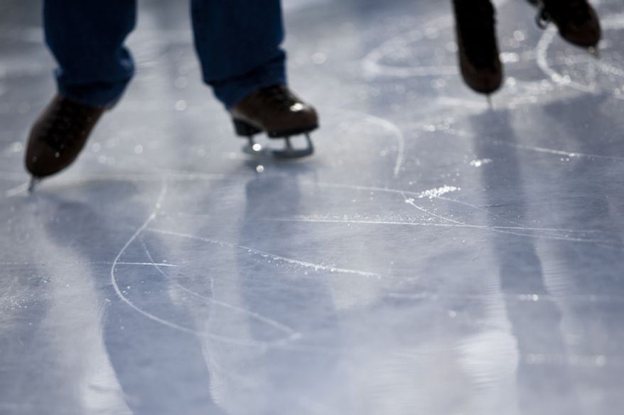 Skaters lay down fresh tracks after a pass of the Zamboni.