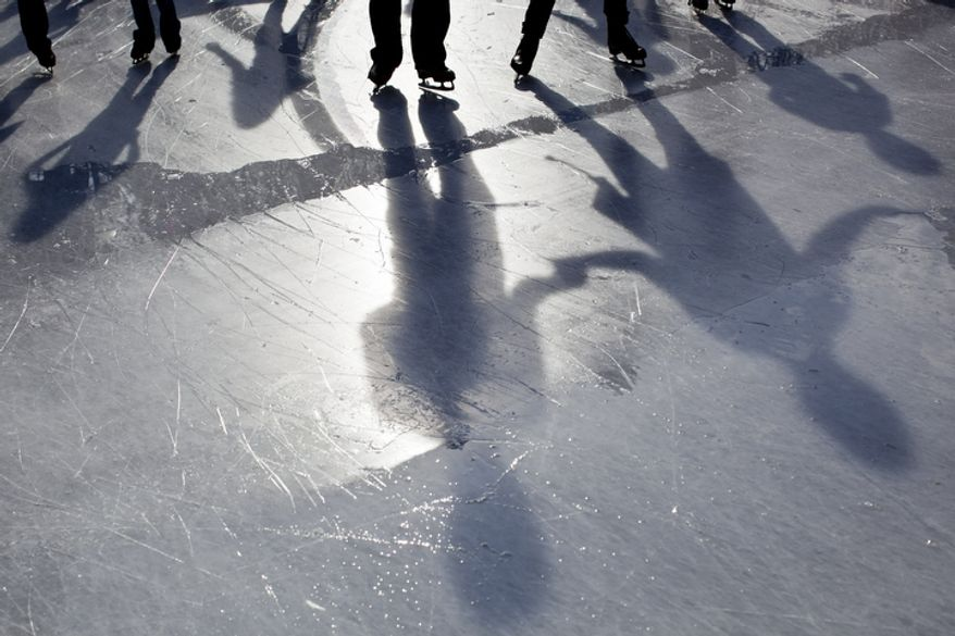 A break in the clouds allows enough sunlight to cast the shadows of skaters on the rink during the opening weekend of the National Gallery of Art sculpture garden ice rink in Washington, D.C. on Nov. 20, 2011.(T.J. Kirkpatrick/ The Washington Times)