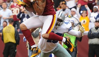 ** FILE ** Washington Redskins wide receiver Jabar Gaffney (10) hauls in a 16-yard touchdown in front of Dallas Cowboys free safety Gerald Sensabaugh (43) during second quarter action. (Andrew Harnik/The Washington Times)