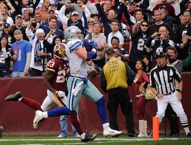 Dallas Cowboys tight end Jason Witten (82) runs past Washington Redskins cornerback DeAngelo Hall (23) to finish off a 59-yard touchdown during fourth quarter action. (Andrew Harnik/The Washington Times)