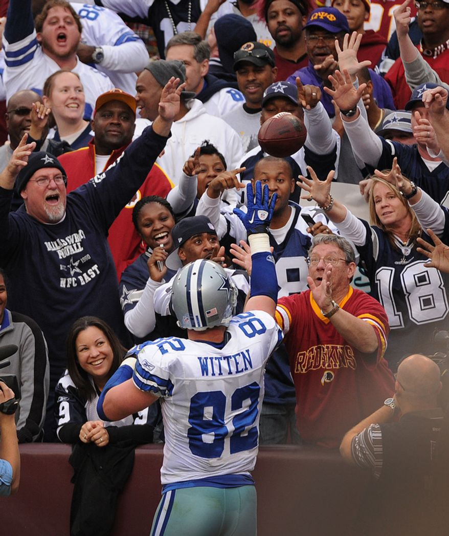 Dallas Cowboys tight end Jason Witten (82) throws the ball into the stands after his fourth quarter touchdown. (Andrew Harnik/The Washington Times)