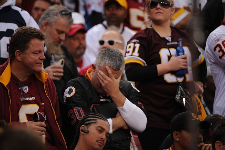 Redskins fans react after Dallas Cowboys tight end Jason Witten (82) scored on a 59-yard touchdown in the fourth quarter. (Andrew Harnik/The Washington Times)