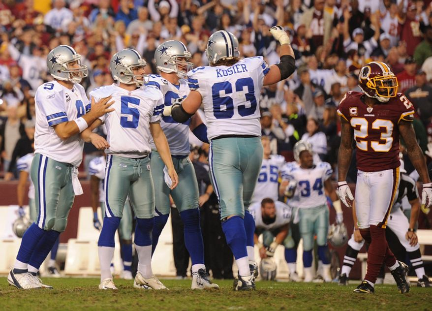 The Dallas Cowboys celebrate kicker Dan Bailey's (5) game-winning field goal in overtime. (Andrew Harnik/The Washington Times)