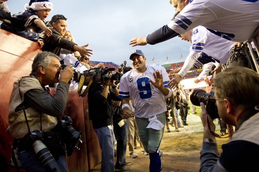Dallas Cowboys quarterback Tony Romo runs off the field after defeating the Washington Redskins 27-24 in overtime at FedEx Field in Landover, Md, Sunday, November 20, 2011. (Rod Lamkey Jr. / The Washington Times)