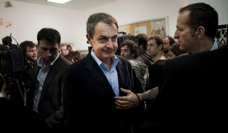 Spain's Prime Minister Jose Luis Rodriguez Zapatero leaves after voting and giving a speech at a voting station in Madrid, Sunday, Nov, 20, 2011. (AP Photo/Daniel Ochoa de Olza)