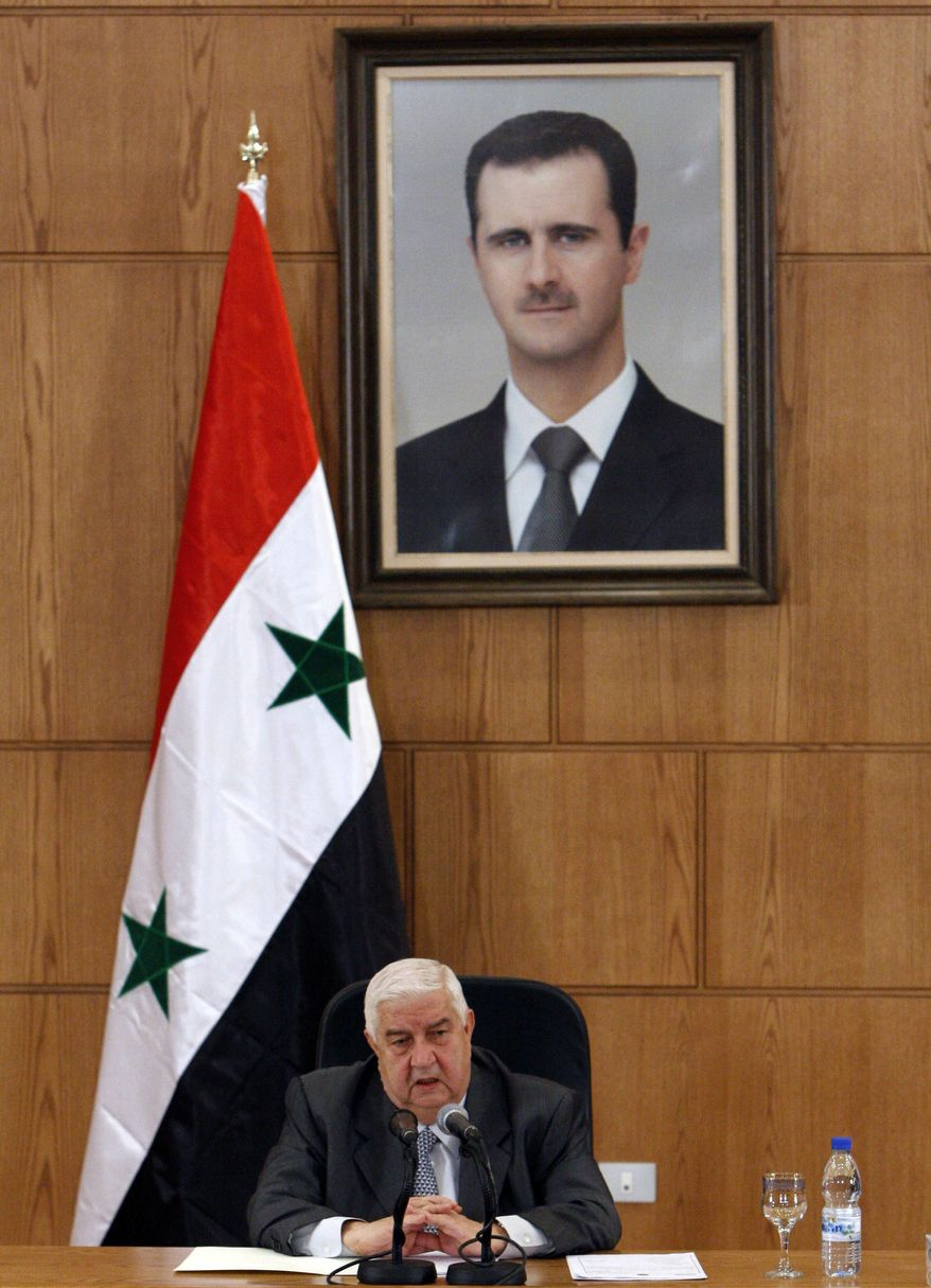 Syrian Foreign Minister Walid al-Moallem speaks during a press conference, in Damascus, Syria, on Monday Nov. 14, 2011. (AP Photo/Muzaffar Salman)