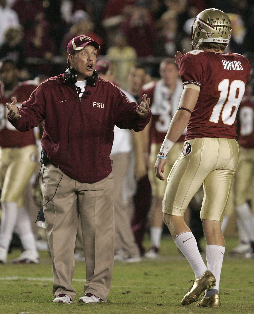 Florida State's head coach Jimbo Fisher talks with his field goal kicker Dustin Hopkins in the last seconds of the game against Virginia in an NCAA college football game which Virginia won 14-13 on Saturday, Nov. 19, 2011, in Tallahassee, Fla.(AP Photo/Steve Cannon)