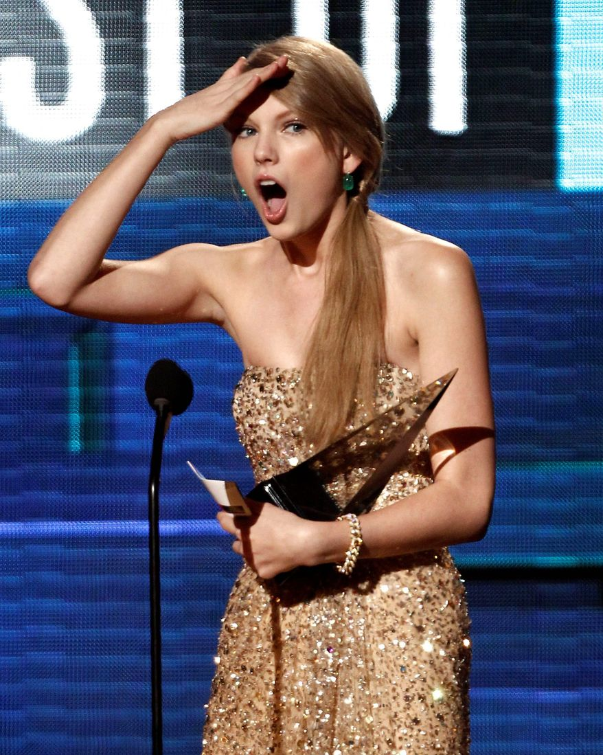 Taylor Swift was the darling of the American Music Awards on Sunday night, when the 21-year-old collected her second honor as artist of the year. (Associated Press)