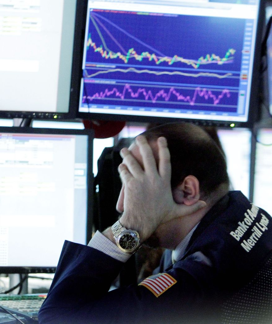A specialist ponders the sell-off day on the floor of the New York Stock Exchange on Monday. Five stocks fell for every one that rose during trading. The markets were reacting to the failure of the congressional supercommittee to reach a deal on federal budget deficit reduction. (Associated Press)