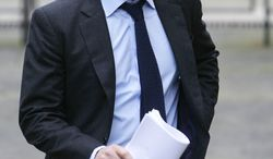 ** FILE ** Actor Hugh Grant prepares on Monday, Nov. 21, 2011, in London to give evidence before an inquiry panel headed by Lord Justice Brian Leveson that is probing the British phone-hacking scandal. (Associated Press)