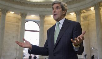 Supercommittee member Sen. John Kerry, Massachusetts Democrat, gestures Nov. 21, 2011, during a TV interview on Capitol Hill about the deficit reducing panel's unfinished work. (Associated Press)