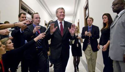 Supercommittee member, Senate Finance Committee Chairman Sen. Max Baucus, Montana Democrat, fends off reporters as he arrives to meet in the Capitol Hill office of Sen. John Kerry, Massachusetts Democrat, with other Supercommittee members as time for action by the deficit reduction panel grows short, Monday Nov. 21, 2011, of Capitol Hill in Washington. (AP Photo/J. Scott Applewhite)