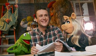 "In this film publicity image released by Disney, Jason Segel is shown with muppet characters Kermit the Frog, left, and Miss Piggy, in a scene from ""The Muppets."" (AP Photo/Disney Enterprises, Andrew Macpherson)"