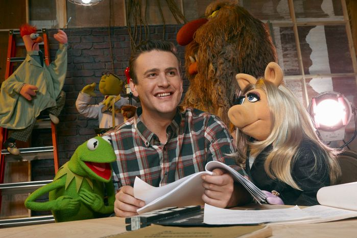 """In this film publicity image released by Disney, Jason Segel is shown with muppet characters Kermit the Frog, left, and Miss Piggy, in a scene from """"The Muppets.&am"""