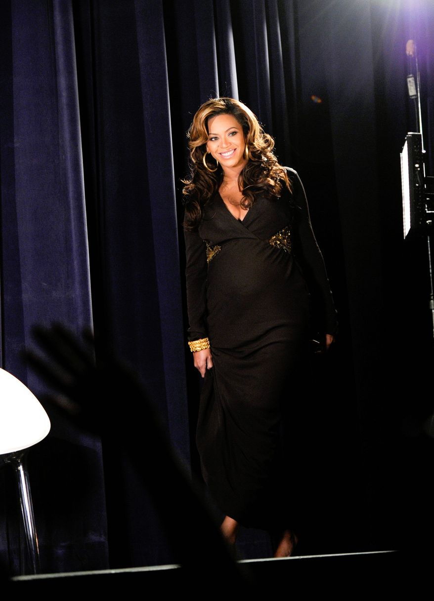 """Singer Beyonce Knowles introduces """"Beyonce Live At Roseland: The Elements of 4"""" live concert film at a special screening for fans at the Paris Theatre on Sunday, Nov. 20, 2011 in New York. (AP Photo/Evan Agostini)"""
