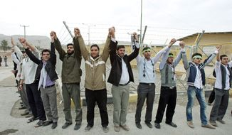 Iranians form a human chain this month around the Isfahan uranium conversion facility to urge their government to block international inspectors. More than 2,000 university students turned out for the demonstration, saying they were ready to sacrifice themselves to defend their country's nuclear rights, according to state media. (Associated Press)
