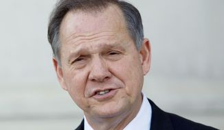 Former Alabama Supreme Court Chief Justice Roy Moore announces his candidacy Tuesday in a bid to reclaim the post in Montgomery, Ala. Two others, including the incumbent, are already running in the Republican primary on March 13. (Associated Press)