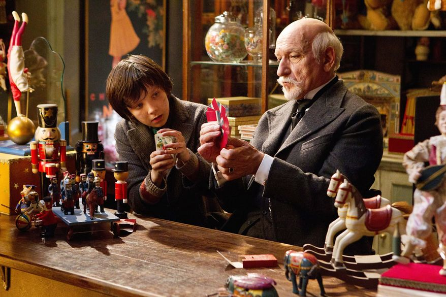 "Asa Butterfield (left) as Hugo Cabret and Ben Kingsley as Georges Melies bond over their obsession with innovation in the new Martin Scorsese 3-D movie ""Hugo,"" which celebrates Frenchman Melies' life as a filmmaker. (Paramount Pictures via Associated Press)"