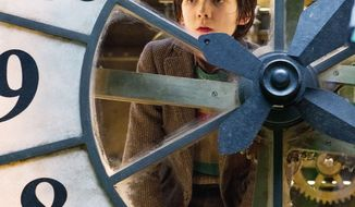 "Asa Butterfield portrays Hugo Cabret in ""Hugo."" The movie, Martin Scorsese's first directing effort in 3-D, tells the story of an orphaned boy who maintains clocks in a train terminal. (Paramount Pictures via Associated Press)"