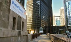 Bank of America advertising banners are seen Nov. 17, 2011, on bridge houses along the Chicago River in downtown Chicago. The advertisements installed this month are turning heads and reviving a debate over how governments around the world raise money in tough economic times. (Associated Press)