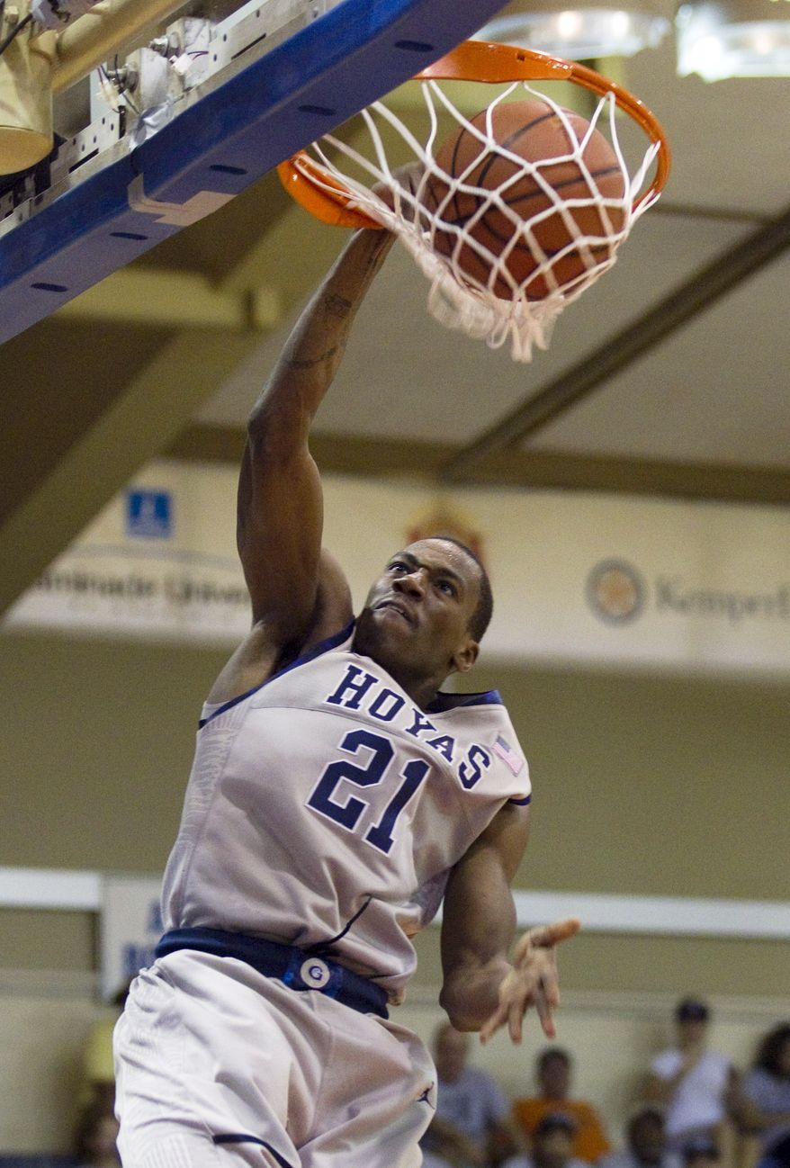 Georgetown guard Jason Clark (21) breaks away for a dunk in the second half of an NCAA college basketball game Tuesday, Nov. 22, 2011, in Lahaina, Hawaii. Georgetown defeated Chaminade 88-61. (AP Photo/Eugene Tanner)