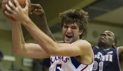 Kansas center Jeff Withey (5) blocks out Georgetown guard Jason Clark for a rebound in the second half of Kansas' 67-63 win on Nov. 21, 2012, in Lahaina, Hawaii. (Associated Press)