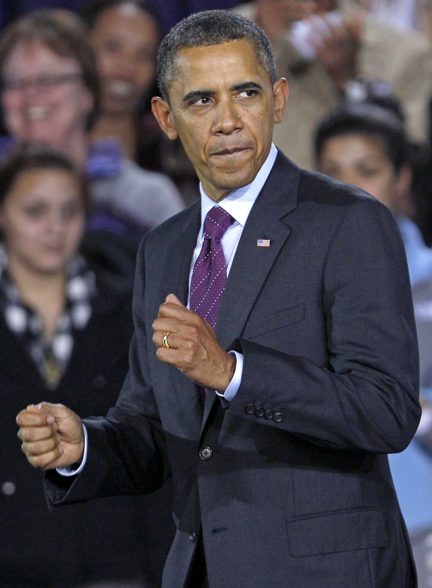 President Obama gestures Nov. 22, 2011, as he heads to shake hands with the crowd at Central High School in Manchester, N.H., following an address where he remarked on the American Jobs Act. (Associated Press)