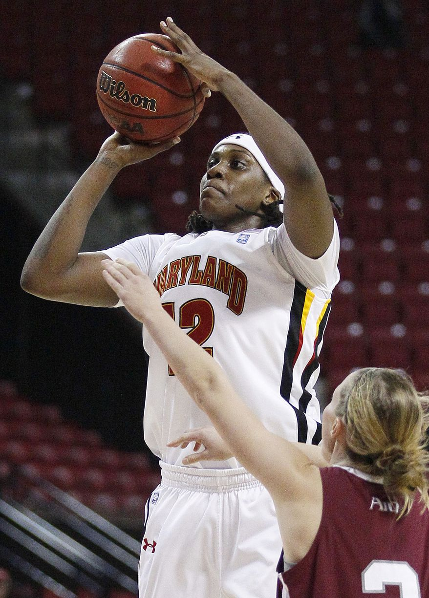 Maryland center Lynetta Kizer shoots over St. Joseph's guard Erin Shields in the second half of a college basketball game in College Park, Md., Tuesday, Nov. 22, 2011. Kizer contributed a game-high 25 points to Maryland's 94-71 win. (AP Photo/Patrick Semansky)