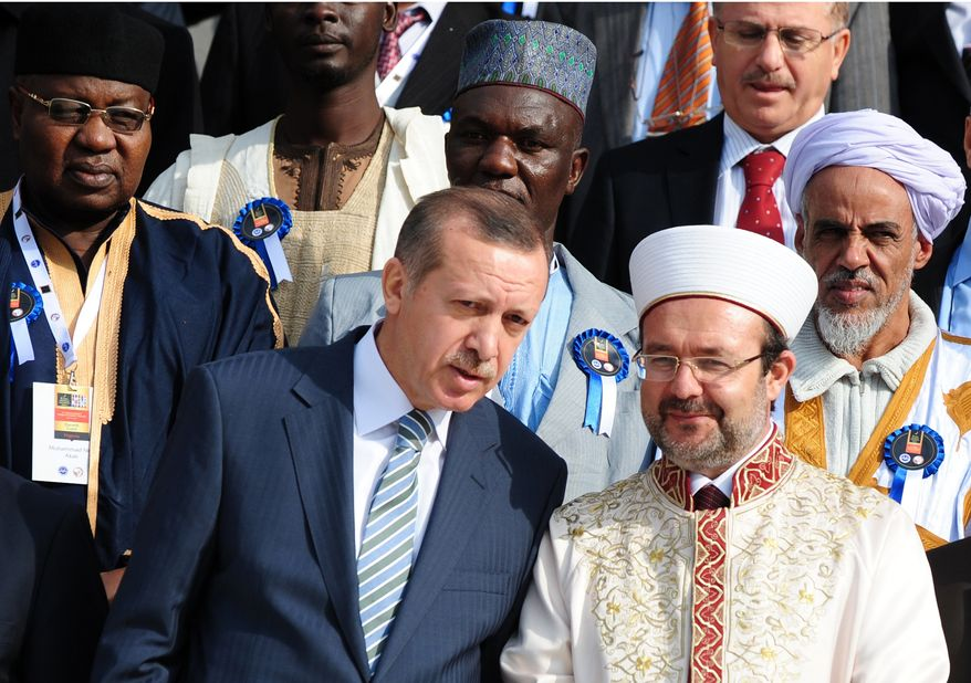 Turkish Prime Minister Recep Tayyip Erdogan, front left, speaks with Mehmet Gormez, head of Turkey's Religious Affairs Directorate, after a meeting with African Muslim religious leaders in Istanbul, Turkey, Monday, Nov. 21. 2011. (AP Photo)
