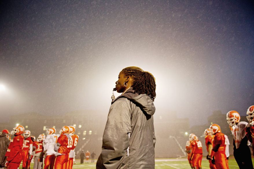 Coolidge High School varsity football coach Natalie Randolph is in her second year of coaching and some of the novelty of a woman heading a boys football team has worn off. (Andrew Harnik/The Washington Times)