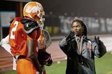 Coolidge receiver Dayon Pratt listens to instructions from head coach Natalie Randolph. (Andrew Harnik/The Washington Times)