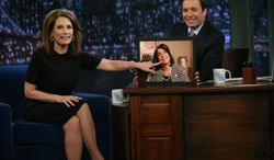Jimmy Fallon apologized Tuesday to presidential hopeful Michele Bachmann for the unflattering introduction played when she appeared on his show Monday. (NBC via Associated Press)