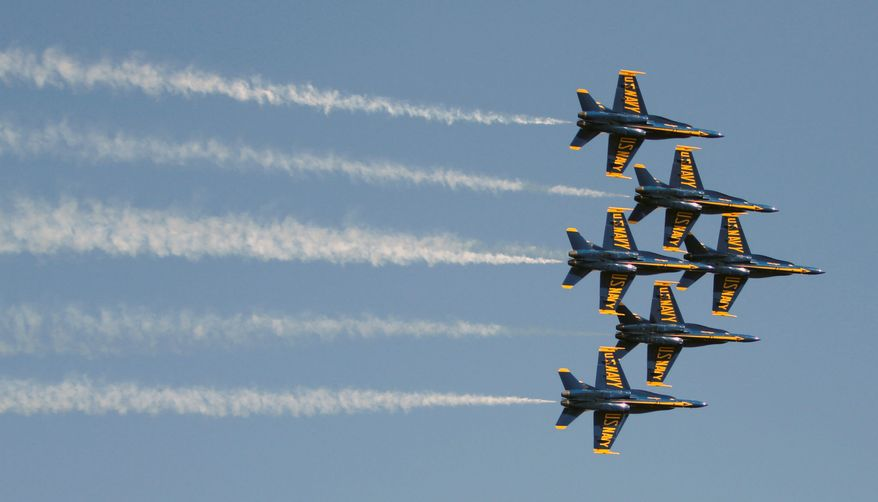 The Navy Blue Angels have been thrilling audiences for more than six decades. But federal budget woes and proposed deficit cutting have some inside and outside the military raising questions about the millions it costs annually to produce military air shows. (Associated Press)