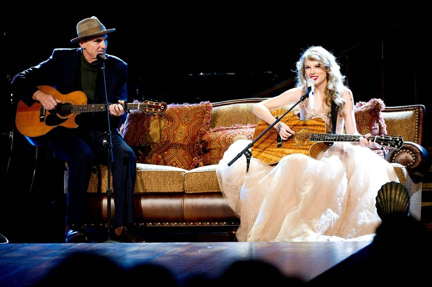 Taylor Swift performs with special guest James Taylor at Madison Square Garden, in New York, on Tuesday to wrap up her Speak Now World Tour. Her parents were fans of Mr. Taylor and they named their daughter after him. (Associated Press)